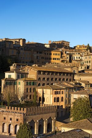 The ancient town of Siena with old houses in the evening. Toscana (Tuscany), Italy, Europe