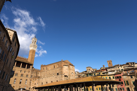 The Torre del Mangia 87 m. in the market square (Tower of Mangia) 1348. Ancient city of Siena, Toscana (Tuscany), Italy