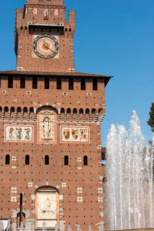xv century: Detail of the clock tower of the Sforza Castle XV century (Castello Sforzesco) and the fountain. It is one of the main symbols of the city of Milan, Lombardy, Italy