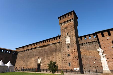 xv century: Sforza Castle XV century (Castello Sforzesco) in Milan, Lombardy, Italy with Tower of Bona and Giovia and statue of St. Giovanni Nepomuceno, Bohemian priest