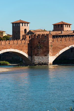 scala: Detail of the ancient Scaligero bridge near Castelvecchio (Old Castle) and Adige river in Verona (UNESCO world heritage site) - Veneto, Italy