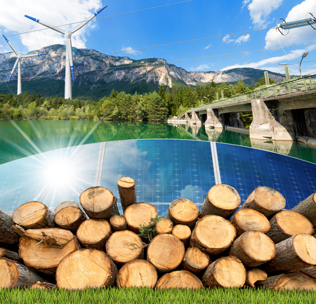 water turbine: Renewable energies sources - Wind energy (wind turbines),  solar energy (solar panels), biomass (tree trunks) and hydropower (dam for hydroelectric power) Stock Photo