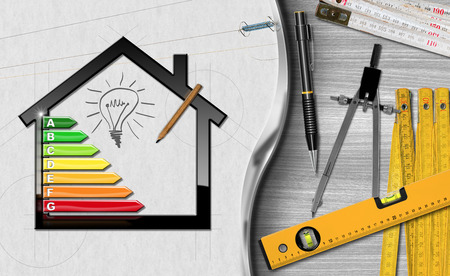 House with energy efficiency rating (3D illustration) on a desk with folding rulers, pencils and a drawing compass (photo). Project of ecological house Stock Photo