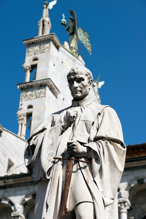 Lucca - Statue of Francesco Burlamacchi (1863) of the sculptor Ulisse Cambi. In the background the church of San Michele in Foro. Toscana (Tuscany), Italy, Europe