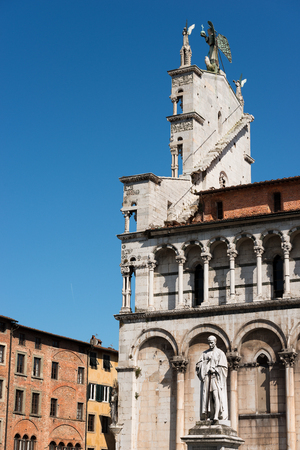 Detail of the church of San Michele in Foro and the statue of Francesco Burlamacchi in the ancient town of Lucca, Toscana (Tuscany), Italy, Europe Stock Photo