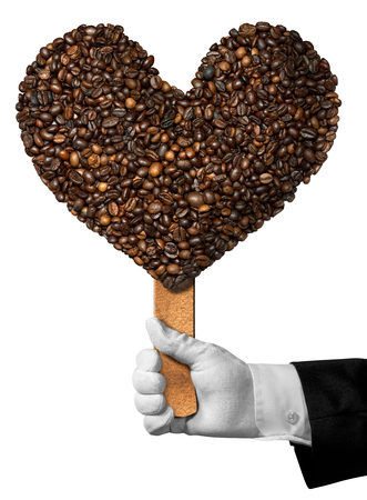 heart shaped: Love Coffee - Hand of a waiter holding a symbol with roasted coffee beans in the shape of a heart. Isolated on white background Stock Photo