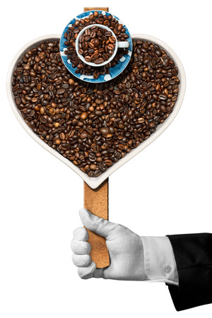 heart shaped: Love Coffee - Hand of a waiter holding a symbol with roasted coffee beans in the shape of a heart with a coffee cup. Isolated on white background