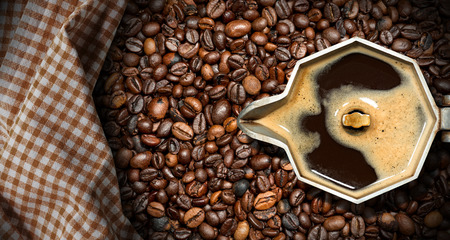 aluminum: Old italian coffee maker (moka pot - top view) with roasted coffee beans on the background with a checkered tablecloth Stock Photo