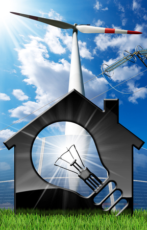 Model house with a light bulb, solar panel, wind turbine and a power line on a blue sky with clouds, sun rays and green grass - Renewable energies concept