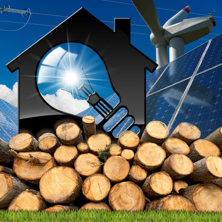 3D illustration of a model house with a light bulb, solar panels, wind turbine, tree trunks and a power line on a blue sky - Renewable resources concept