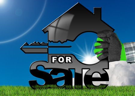 Hand with work glove holding a model house with a key (3D illustration) and text for sale. On a green grass and blue sky with clouds and sun rays