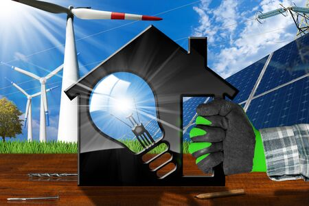 Hand with work glove holding a model house (3D illustration) with a light bulb, solar panels, wind turbines and a power line on a wooden desk and sky - Renewable resources concept