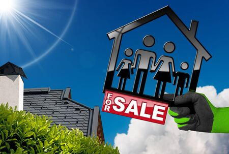 Hand with work glove holding a model house with a symbol of a family and text For Sale - 3D illustration. On a blue sky with a roof of a residential house Stock Photo