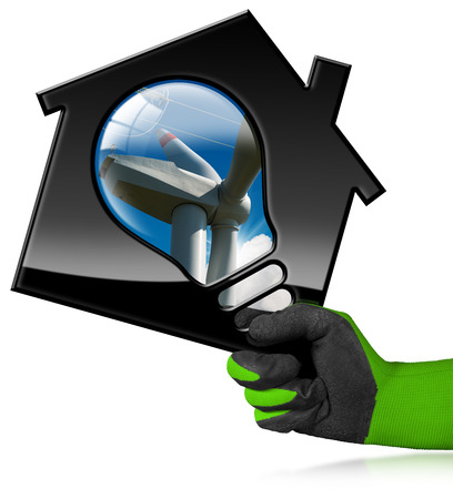 Hand with work glove holding a 3D illustration of a model house with a light bulb, wind turbine and a power line. Isolated on a white background - Renewable energy concept