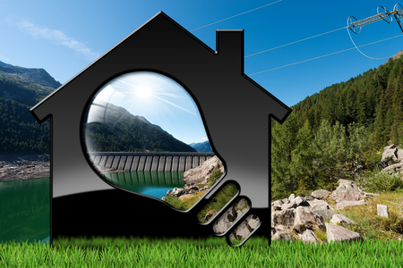3D illustration of a model house with a light bulb and a dam for hydroelectric power -  Renewable resource concept