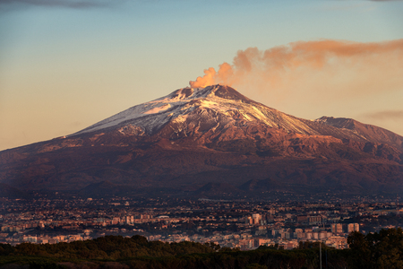 The mount Etna Volcano with smoke and the Catania city, Sicily island, Italy (Sicilia, Italia)