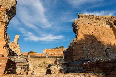 Ancient Greek Roman theater at sunset in Taormina town, Messina, Sicily island, Italy (II century AD) Stock Photo