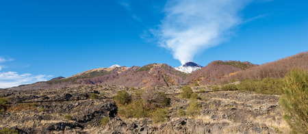 The mount Etna Volcano with snow and smoke in Sicily, Catania, Italy (Sicilia, Italia) Europe Stock Photo