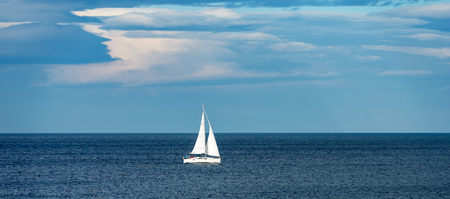 Sailing ship yacht (sailboat) in the Mediterranean Sea with blue sky and clouds Stock Photo