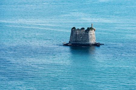 The Scola Tower (Torre Scola) XVII century in the Gulf of La Spezia or Gulf of poets (Golfo dei poeti). La Spezia, Liguria, Italy Stock Photo