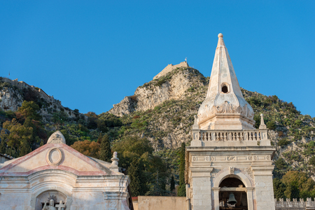 Close up of the Church of San Giuseppe (St. joseph) and the hills in the Taormina town, Messina, Sicily island, Italy, Europe