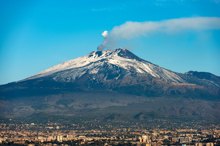The mount Etna Volcano with smoke and Silvestri craters in the Catania city, Sicily island, Italy (Sicilia, Italia) Europe