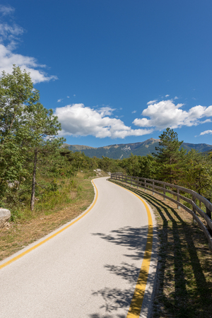 Bicycle path in the Sarca Valley (Valle del Sarca) through the forest. Trentino Alto Adige, Italy, Europe