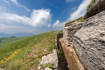 Ancient natural trenches of the First World War. Regional Natural Park of the plateau of Lessinia, Veneto, Verona, Italy, Europe Stock Photo
