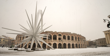 The Arena di Verona in winter while it snows (I-III century). Veneto, Italy, Europe Banque d'images