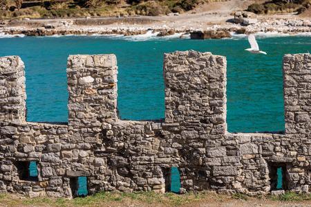 Fortified Wall of the small town of Porto Venere or Portovenere. Gulf of La Spezia, Liguria, Italy, Europe Stock Photo