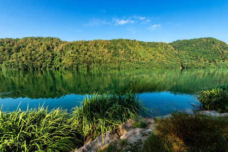Lago di Levico (Lake) with mountain and forest, Levico Terme,  Italy, Europe