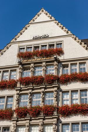 MUNICH, GERMANY - SEPT 6, 2018: Building Zum Schonen Turm (The beautiful tower) Hirmer company fashion store in Kaufinger strasse near Marienplatz. Munich, Germany