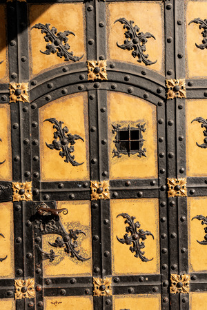 Close up of an ancient door of the Neue Rathaus of Munich (New Town Hall) XIX century neo-Gothic style palace in Marienplatz, the town square in historic center. Germany, Europe