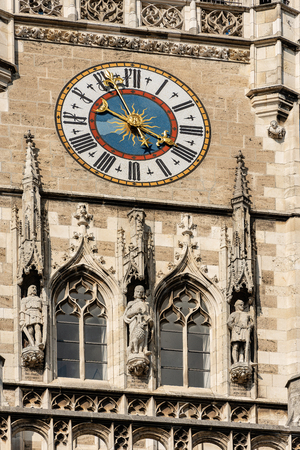 Close-up of the clock tower of the Neue Rathaus of Munich (New Town Hall) XIX century neo-Gothic style palace in Marienplatz, the town square in historic center. Germany, Europe