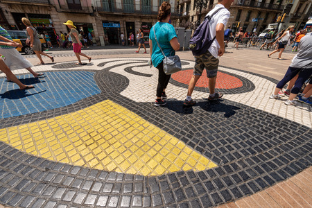 BARCELONA, SPAIN - JUNE 13, 2014: Mosaic del Pla de l'Os by Joan Miro in the middle of the Rambla, the most important road in Barcelona, Catalonia, Spain