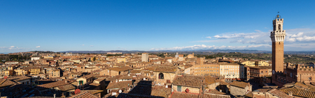 The Cityscape of Siena with the Torre del Mangia 87 m. (Tower of Mangia). Tuscany, Italy, Europe Banco de Imagens