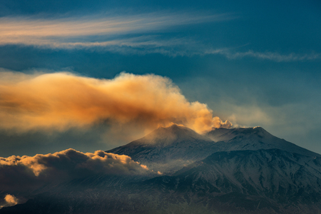 The mount Etna Volcano with smoke at sunset in winter. Catania, Sicily island, Italy, Europe