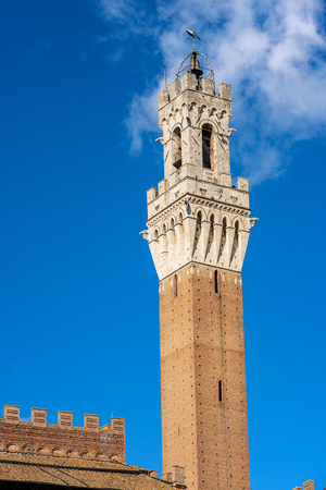 The Torre del Mangia in Piazza del Campo, 1348. In the ancient city of Siena, Tuscany, Italy, Europe