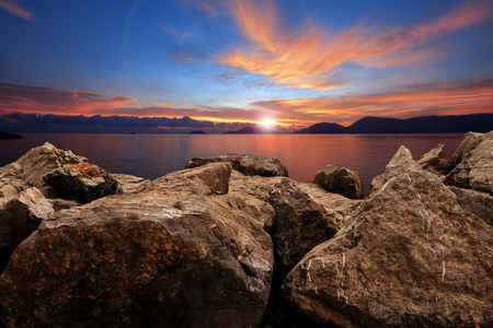 Sunset on the Mediterranean Sea with breakwater, Gulf of La Spezia, Liguria, Italy.
