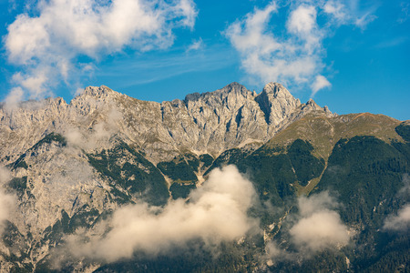 Alps in Austria near Innsbruck at summer with blue sky and clouds, Europe