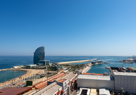 Aerial view of Barceloneta Beach and the port of Barcelona from the cableway to the Montjuic hill. Catalonia, Spain, Europe
