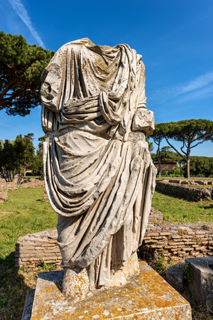 Ancient roman statue with tunic in Ostia Antica, Roman colony founded in the 7th century BC Reklamní fotografie