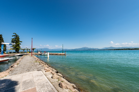 Lago di Garda or Benaco (Lake Garda) near the small town of Peschiera with the italian Alps