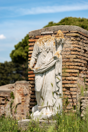 Ancient marble roman statue without head in Ostia Antica, colony founded in the 7th century BC.