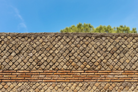 Detail of an ancient Roman brick wall in Ostia Antica