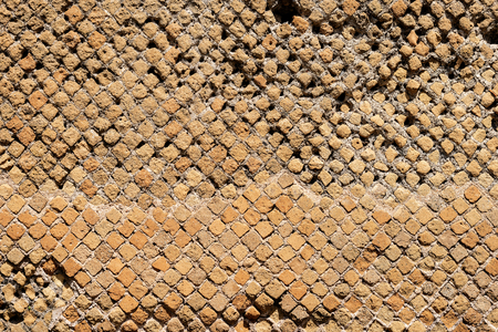 Detail of an ancient Roman brick wall in Ostia Antica, Roman colony founded in the 7th century BC. Reklamní fotografie