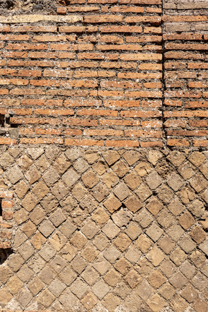 Close-up of an ancient Roman brick wall in Ostia Antica, Roman colony founded in the 7th century BC. Reklamní fotografie