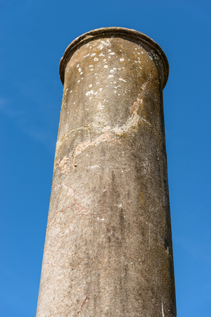 Roman marble column without capital on a clear blue sky in Ostia Antica, colony founded in the 7th century BC.