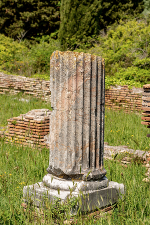 Broken column with pedestal in Ostia Antica, Roman colony founded in the 7th century BC.
