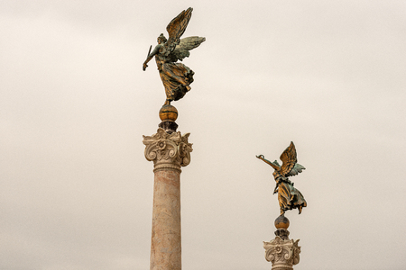 Vittoriano or Altare della Patria (Altar of the Fatherland) two winged victories on columns with capitals.